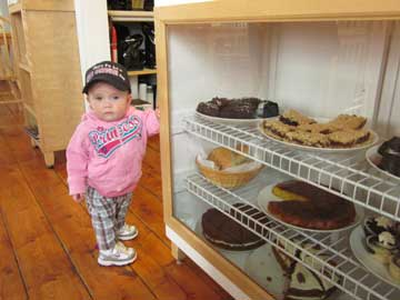 one of our young customers at the cake counter!